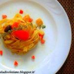 Tagliatelle con zucchine friulane, pomodoro e sentori di bottarga